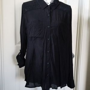 Long sleeve rolled to 3/4. Never worn blouse